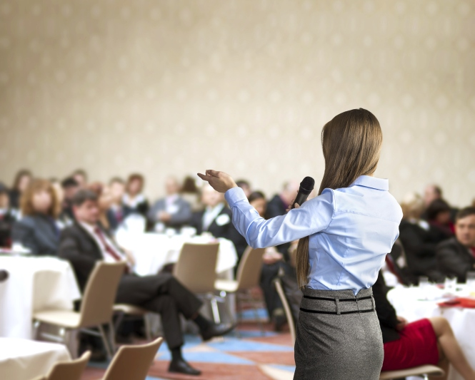 Woman speaking at a business workshop