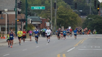 Runners on Main Street in Rochester Hills.