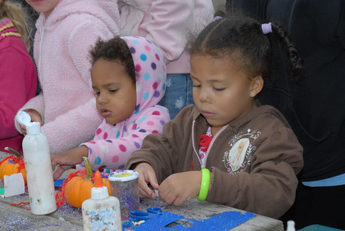 2 little girls making Halloween crafts!