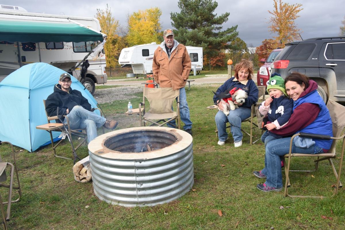 A family enjoys a nice campfire moment.