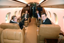 Guests having a blast touring the corporate jet on site.