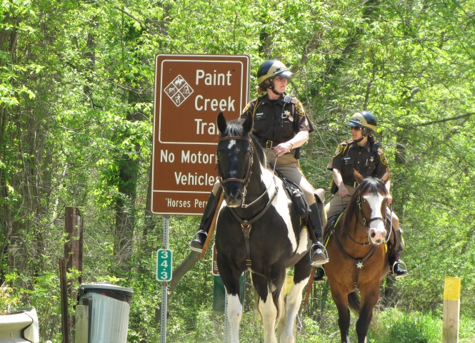 Oakland Sheriff Deputies patrolling Paint Creek Trail.