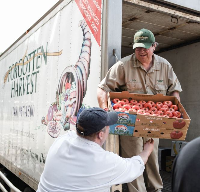 Workers load produce for distribution.