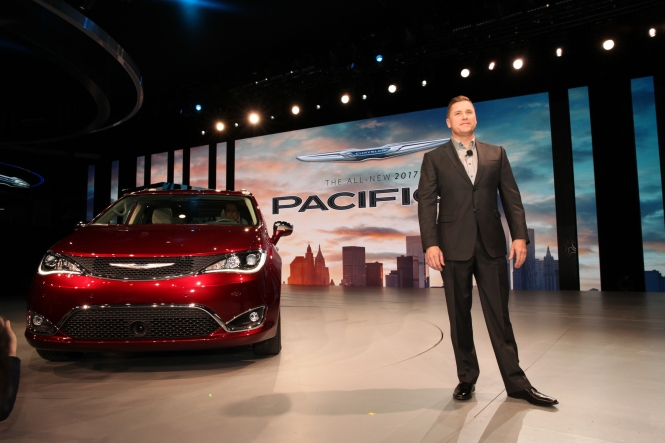 Head of Passenger Car Brands for Fiat Chrysler Automobiles, Tim Kuniskis with the new 2016 Chrysler Pacifica.