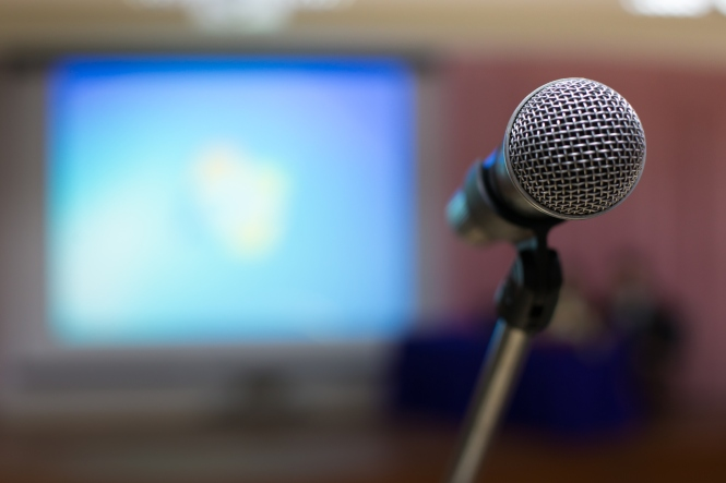 Microphone in a conference room with unfocused background.