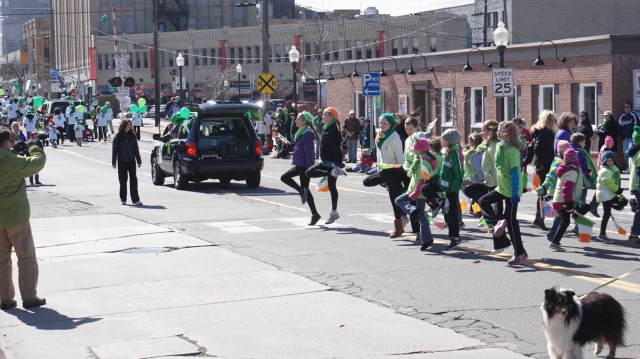Irish dancers in the parade dancing for parade attendees.