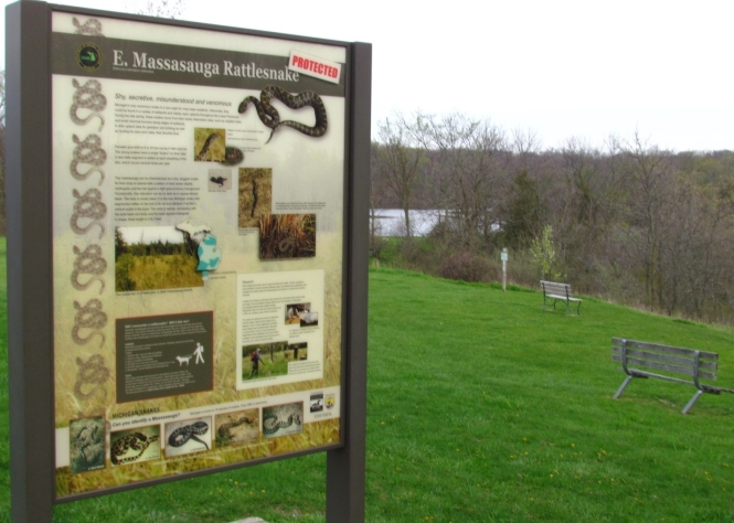 Interpretive signs at Seven Lakes State Park educate visitors about massasauga rattlesnakes