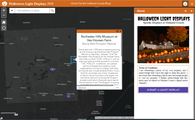 A screen shot of Oakland County's 2018 Holiday LIght Displays Map. The map is dark gray and the cities are listed in white text. Purple pinpoints indicate which cities have a display. The right side of the page opens up with a photo of the display that's being clicked on. It shows a photo of pumpkins lined up on stone wall at night with text about the location.