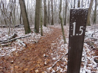 A trail marker with 1.5 on it.