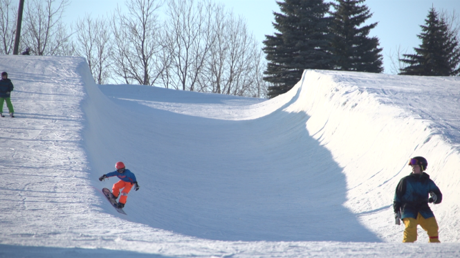 Three riders test their skills on one of the ski area's ramps.