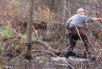 swamp tromping to set camera trap